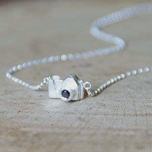 Silver Camera Necklace With A Black Diamond
