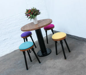 Button Pedestal Table With Four Upholstered Stools - dining tables
