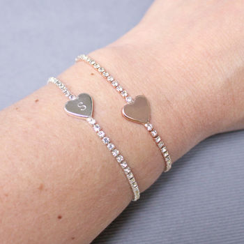 silver diamante bracelet with hand stamped heart charm on wrist