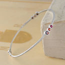 Silver Garnet And Ruby Triple Stone Bangle