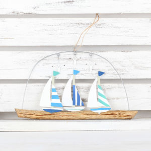 Hanging Striped Or Spotted Sails Yachts On Driftwood