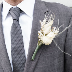 Three White Buttonholes