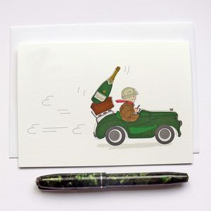 Racing Pedal Car With Bottle Of Champagne Greeting Card