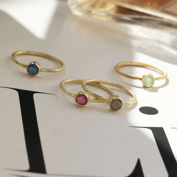 Gemstone and brushed gold rings