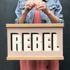 Framed Rebel Hanging Poster Print In Plaster Pink