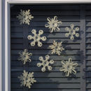 Set of wooden snowflakes on window