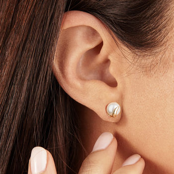 A Pair Of Solid Gold Pearl Stud Earrings