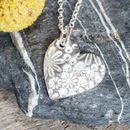 Silver Rounded Sunflower Print Heart Necklace