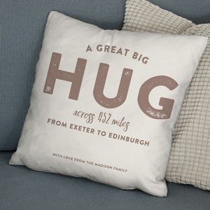 'A Hug All The Way From' Personalised Locations Cushion - bedroom