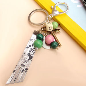 Personalised Silver And Leather Charm Keyring