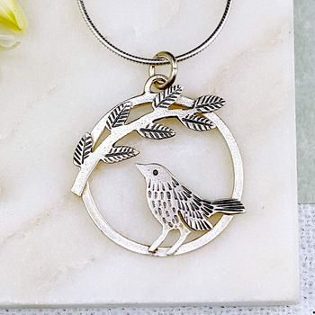 silver leaf pendant with bird