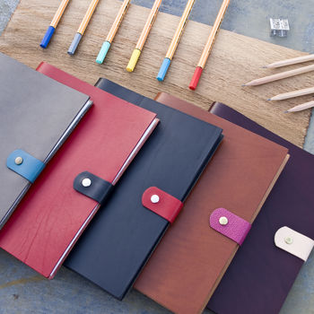 multiple colour leather notebooks by John Todd