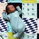 baby on the mint patchwork play amt