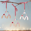 A Wooden Mistletoe Tree Decoration For Christmas