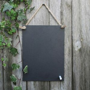 A Rectangular Chalk Board Made From Recycled Packaging