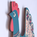 side view of hen wall art showing detail of plywood edge