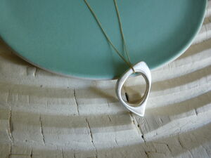 Handcrafted Silver Oval Pendant On Gold