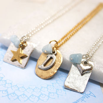 personalised March birthstone necklace in silver and gold with aquamarine