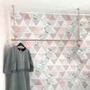 Copper clothes rail with copper hangers