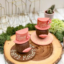 Pink Hat And Lips On A Chocolate Round