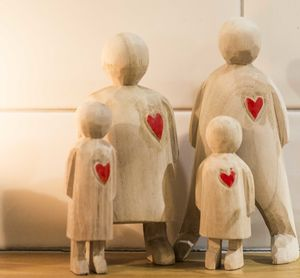 Hand Crafted Wooden Heart Family - sculptures