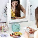 Girl reading mindfulness card from can of can-do at dressing table