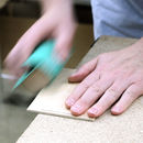 one of our wooden products being hand-finished in the studio