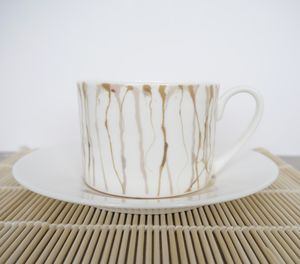 Spill Tea Cup And Saucer