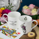 A fine bone china mug with an illustration of the White Rabbit from Alice in Wonderland