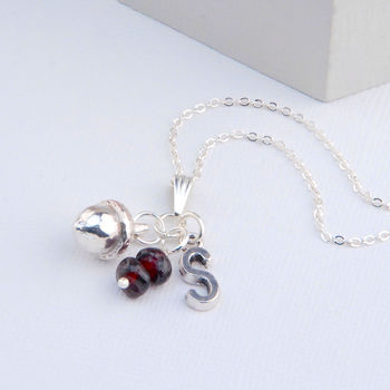 Garnet (January) with acorn charm on a fine chain