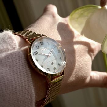 Ladies rose gold mesh watch with a white dial