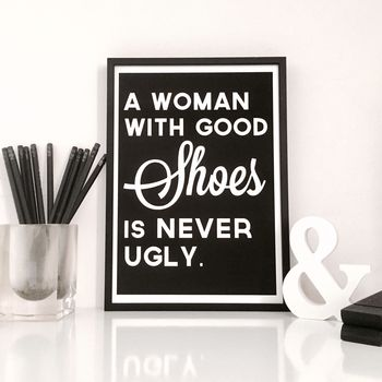 A Woman with Good Shoes Quote Print in Black Background
