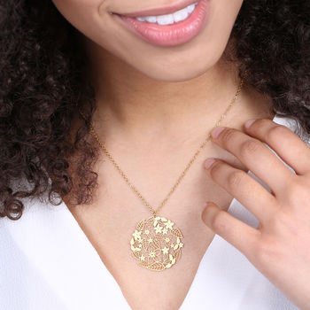 Cut Out Flower Disc In Gold On Model