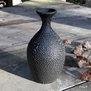 Stoneware Bottle In A Textured Black Bead Glaze