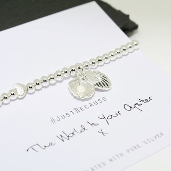 The World Is Your Oyster Charm Bracelet