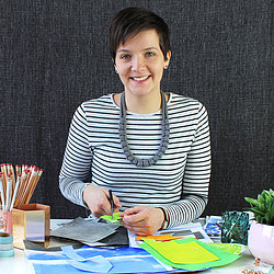 Fiona Clabon sat at her desk creating illustrations