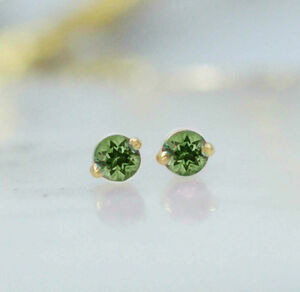 Gold And Silver Peridot Stud Earrings
