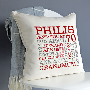 cream cushion - red & grey text
