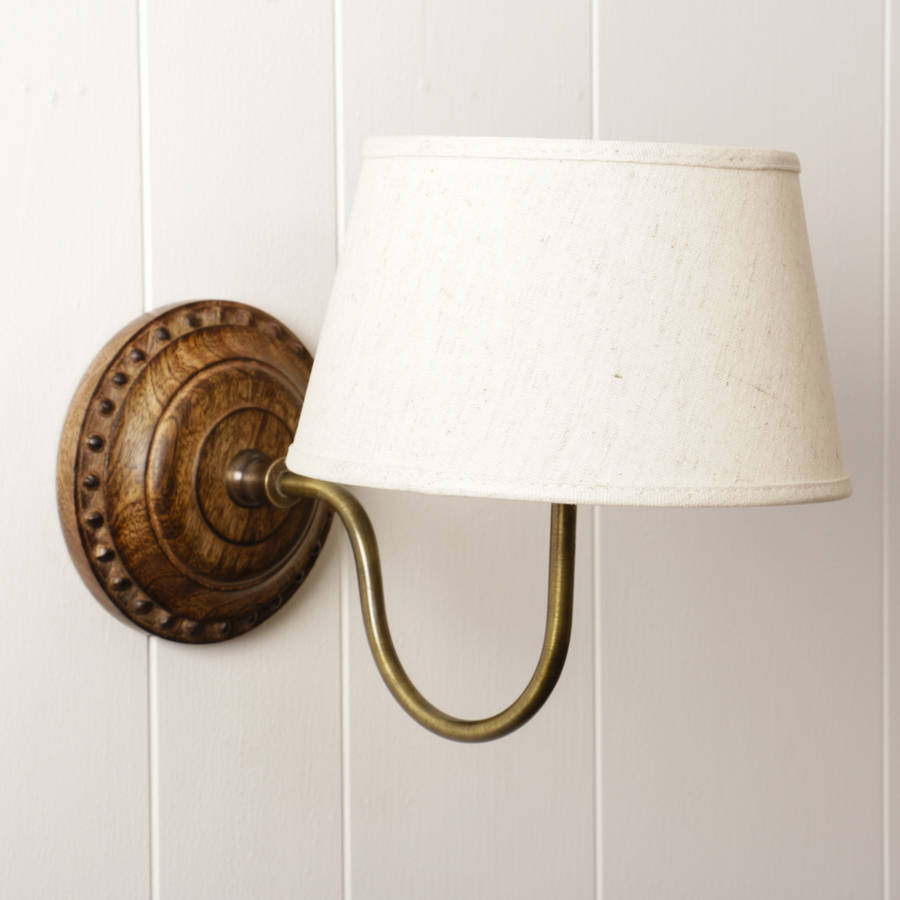 Carved Wood And Brass Wall Light With