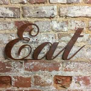 Rusted Metal Eat Word Sign - decoration