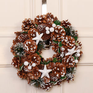 Christmas Wreath With White Frosted Fir And Berries - outdoor decorations