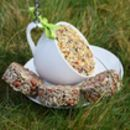 Filled Tea Cup Bird Feeder With Biscuits