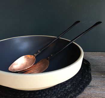 A Set Of Two Blackened And Copper Salad Servers