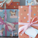 blue unicorn wrap and orange spotty wrap, depending if the gift is for a male or female, cream ribbon or pink ribbon would be used with either the blue cloud tag or orange speech bubble