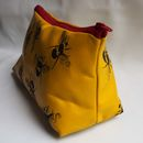 end view yellow bees make up bag