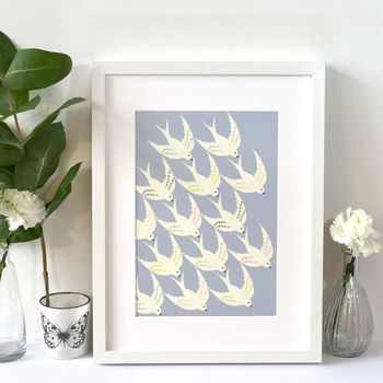 'Birds flying in' framed