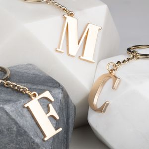 Soft Gold Letter Bag Charm - new in fashion