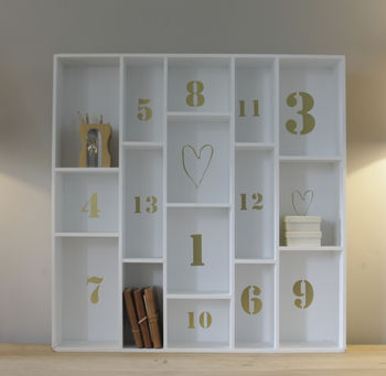 Large Wooden Shelving Unit With Gold Lettering