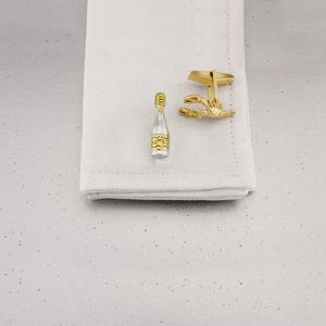 Champagne And Lobster Cufflinks In Silver And Gold