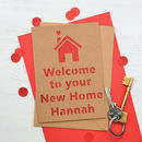 Kraft with red glitter new home cut out card